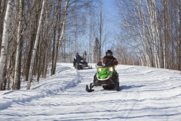 Snowmobiling in Red Top